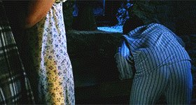 GIF of Hagrid brandishing his umbrella and giving Dudley a pig's tail
