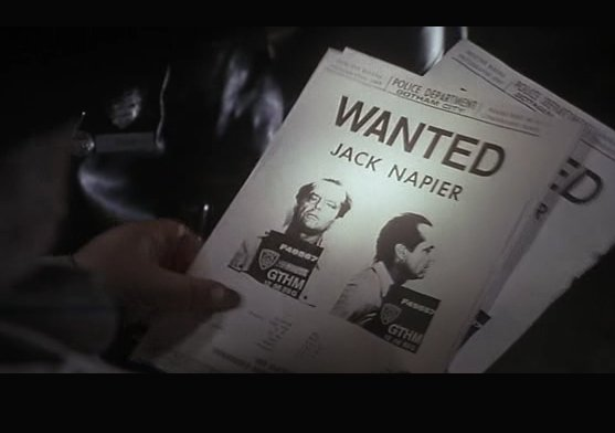 "Hand holding posters that say ""WANTED: Jack Napier"""